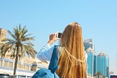 Woman taking mobile photo of the Central Souq in Sharjah City, U. Woman taking mobile photo of the Central Souq market in Sharjah City, United Arab Emirates stock photos