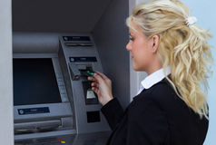 Woman taking a money out Stock Photos