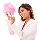 Woman taking money from a piggybank Royalty Free Stock Image
