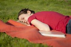 Woman taking a nap in a garden Stock Photo