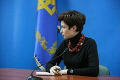Woman taking note. LUTSK, UKRAINE - 02 December 2008: Irina Vannikova - press secretary of President of the Ukraine Stock Photo