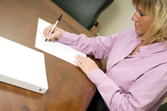 Woman taking notes Stock Photos