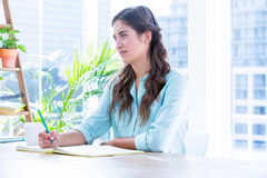 Woman taking notes during a meeting Stock Images