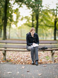 Woman Taking Notes in a Park Stock Photography