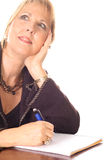Woman taking notes thinking smile. Photo of a woman taking notes thinking smile Stock Photography