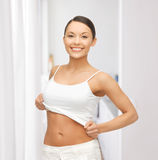 Woman taking off blank white t-shirt Stock Image