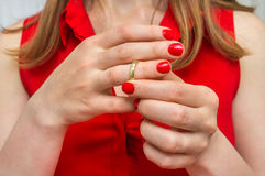 Woman is taking off her wedding ring - divorce concept. Disappointed woman is taking off her wedding ring - divorce concept Royalty Free Stock Photo