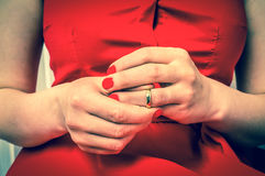 Woman is taking off her wedding ring - divorce concept. Disappointed woman is taking off her wedding ring - divorce concept - retro style Royalty Free Stock Image