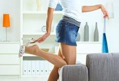 Woman taking off high heel shoe Stock Image