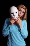 Woman taking off mask Royalty Free Stock Images