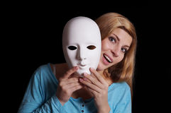 Woman taking off mask Royalty Free Stock Photo