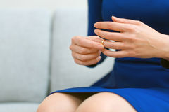 Woman taking off wedding ring. Divorce concept. Woman taking off wedding ring Stock Photo
