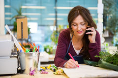 Woman Taking Order In Flower Shop Stock Image