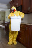 Woman taking our garbage can in Haz Mat Stock Image