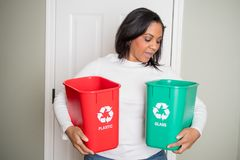 Woman Recycling At Home Stock Photos