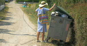 Woman Taking Out the Litter to Street Container stock footage