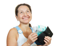 Woman taking out money from a wallet Stock Image