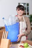Woman taking out the recycling Stock Image