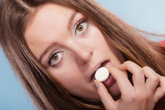 Woman taking painkiller pill tablet. Health care. Royalty Free Stock Photos