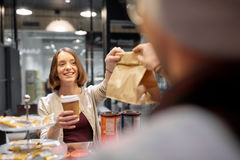 Woman taking paper bag from seller at cafe Royalty Free Stock Photography