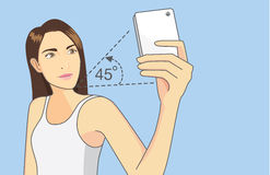 Woman taking a perfect selfie with smartphone Royalty Free Stock Image