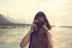 Woman taking photo Royalty Free Stock Photo