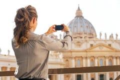 Woman taking photo of basilica di san pietro Royalty Free Stock Photos