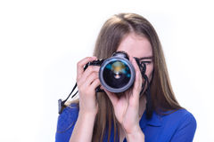 Woman taking a photo with a camera Stock Images