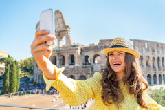 Woman taking photo with cell phone in rome Stock Photos