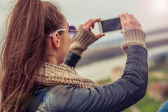 Woman taking a photo with cell phone Royalty Free Stock Photography
