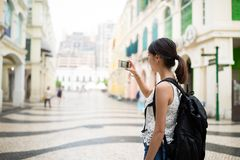 Woman taking photo with digital camera stock photos