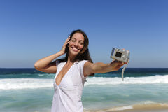 Woman taking a photo with a digital compact camera Stock Photos