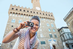 Woman taking photo in front of palazzo vecchio Stock Photos