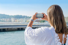 Woman is taking a photo at Gabicce beach Stock Image