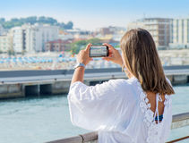 Woman is taking a photo at Gabicce beach Royalty Free Stock Images