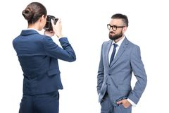 woman taking photo of handsome businessman, stock photo