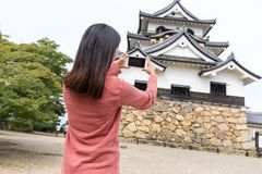 Woman taking photo on Hikone castle Stock Image