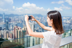 Woman taking photo in Hong Kong Royalty Free Stock Photo