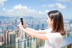 Woman taking photo of Hong Kong Stock Images