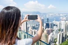 Woman taking photo of Hong Kong city Stock Photos