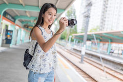 Woman taking photo in Hong Kong light rail station. In Hong Kong Royalty Free Stock Photos