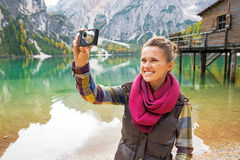 Woman taking photo on lake braies in south tyrol Stock Photography