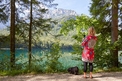 Woman taking a photo of lake Vorder Langbathsee Royalty Free Stock Image