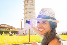 Woman taking photo of leaning tower of pisa Royalty Free Stock Photos