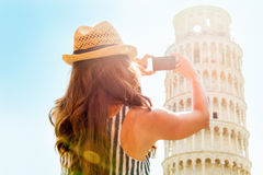 Woman taking photo of leaning tower of pisa, italy Stock Image