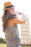 Woman taking photo of leaning tower of pisa, tusca. Happy young woman taking photo of leaning tower of pisa, tuscany, italy Stock Image