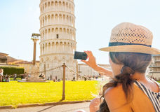 Woman taking photo of leaning tower of pisa Stock Images