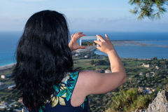 Woman taking photo of Lefkada city Stock Photography