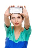 Woman taking photo with mobile cell phone Royalty Free Stock Image