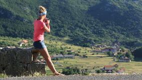 Woman taking photo with mobile cell phone stock video
